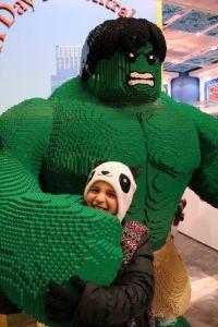 Inside Toys R Us.  Lego Hulk grabs Kaia!